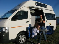 Photo of our used automatic campervans for sale with two ladies enjoying the lovely sunshine