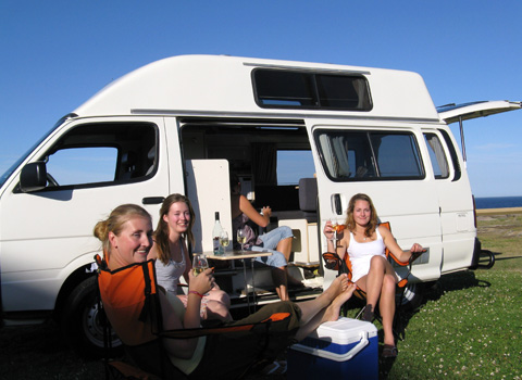Toyota Hiace Campervans for sale - four girls sitting outside the campervan