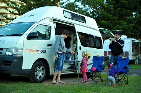 Photo of happy family with kids in our campervan