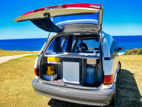 Toyota Automatic Campervan - view of the kitchen with fridge, sink and cooker