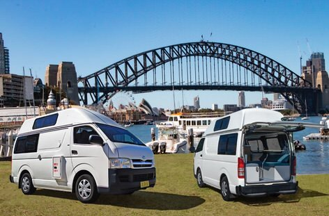 Two campervans in front of Sydney Harbour Bridge