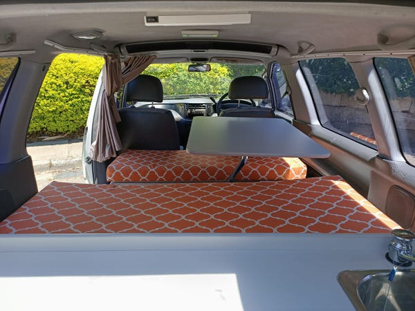 Lounge area inside this Toyota Campervan for sale
